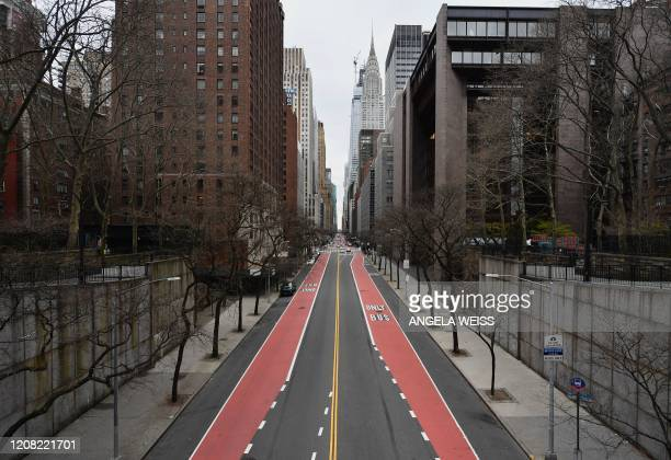 A nearly empty 42nd Street is viewed on March 25 2020 in New York City Wall Street stocks jumped early Wednesday as markets awaited a vote on a $2...