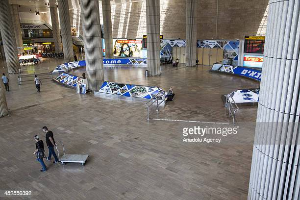 Nearly empty arrival lounge of Ben Gurion International airport near Tel Aviv is seen following several flight cancellations on July 23 2014 due to...