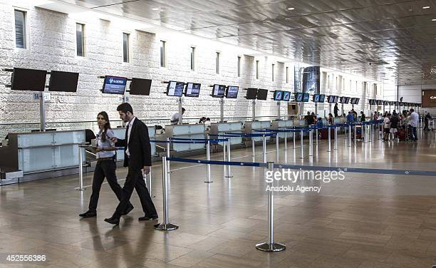 Nearly empty counters at Ben Gurion International airport near Tel Aviv is seen following several flight cancellations on July 23 2014 due to the...