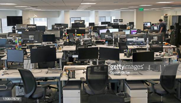 Nearly empty desks at the Fuze office in Boston on March 10 where its 150 on site employees are being asked to work from home amid coronavirus...