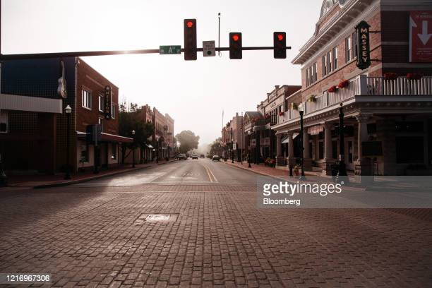 Nearly empty downtown street stands in Bentonville, Arkansas, U.S., on Thursday, May 28, 2020. The annual Walmart Inc. Shareholder celebration...