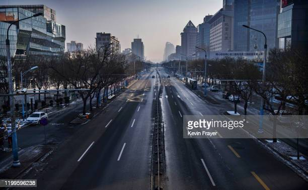 A nearly empty street is seen in a usually busy shopping district on February 9 2020 in Beijing China The number of cases infected with a deadly new...