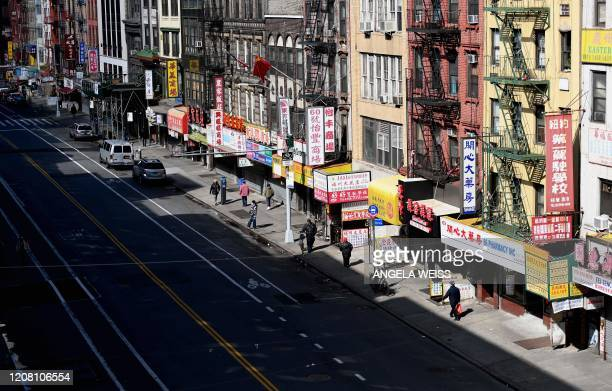 Nearly empty street is seen in Chinatown on March 24, 2020 in New York City. - US lawmakers closed in on a deal Tuesday to help save the teetering...