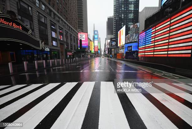 Nearly empty Times Square is seen on March 23, 2020 in New York City. - Wall Street fell early March 23, 2020 as Congress wrangled over a massive...