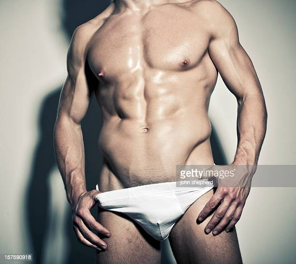 Nearly naked Muscled hunk in white briefs