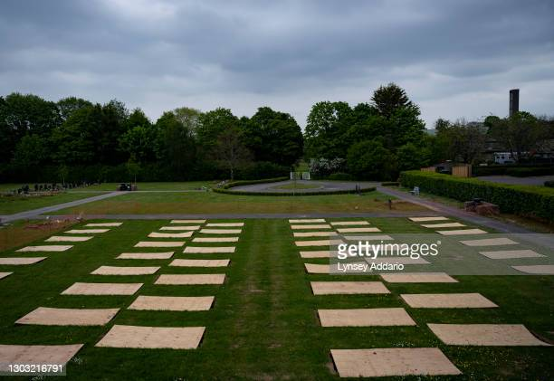 Nearly one hundred graves are pre-dug in preparation for a possible surge in COVID-19-related deaths at the Taunton Deane Crematorium on April 27,...