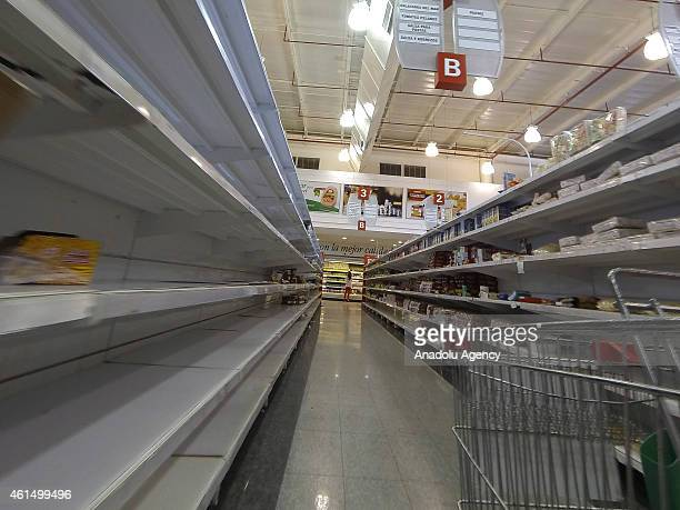 Nearlyempty shelves at a supermarket due to a long term shortage in Caracas Venezuela on January 13 2015 Sliding oil prices have sent Venezuela on a...