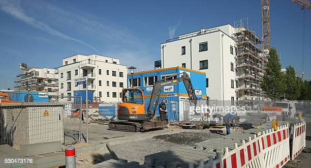 Nearlyfinished apartment buildings stand at the Steglitzer ParkQuartier residential property development on May 10 2016 in Berlin Germany Berlin is...
