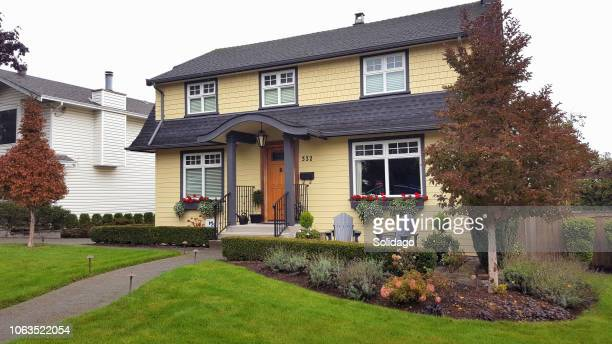 Neat And Trim Dutch Colonial Style Home