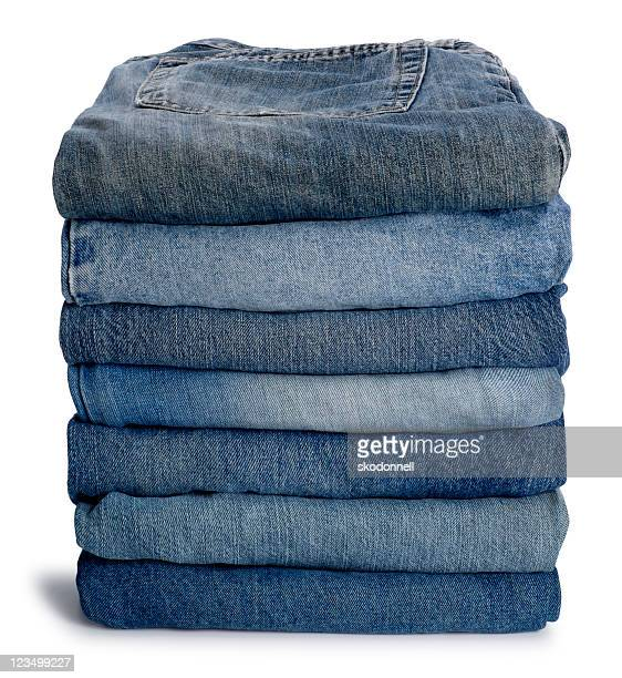 neat stack of blue jeans - trousers stock pictures, royalty-free photos & images