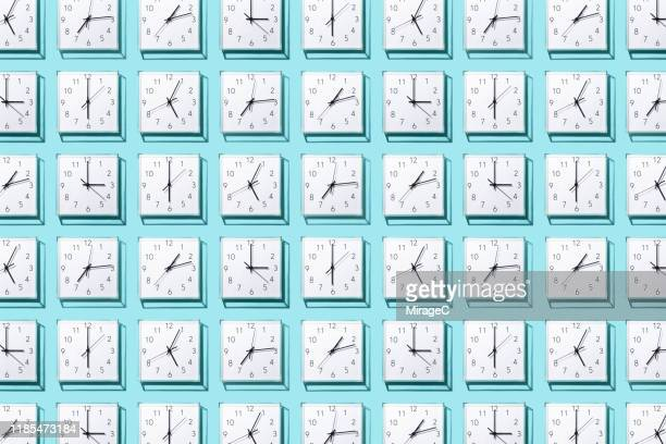 neatly arranged clocks - dag bildbanksfoton och bilder