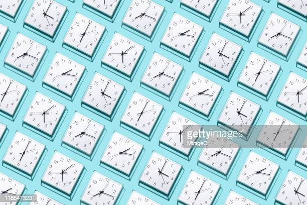neatly arranged clocks - repetition stock pictures, royalty-free photos & images