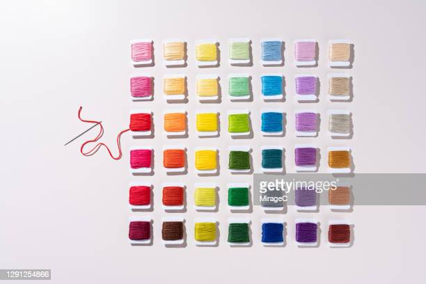 neatly arranged spools of thread collection - embroidery stock pictures, royalty-free photos & images