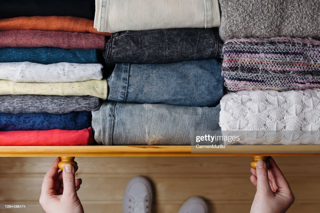 Neatly ordered clothes in drawer : Stock Photo