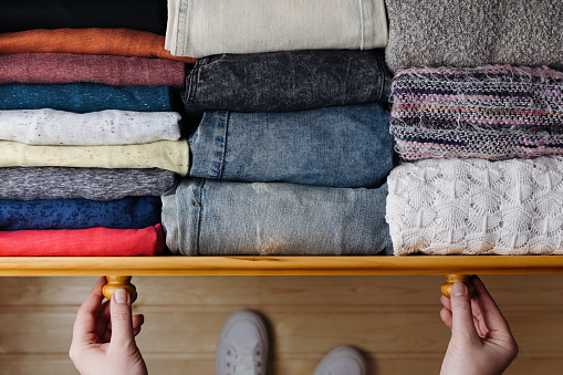 Neatly ordered clothes in drawer 1094438474