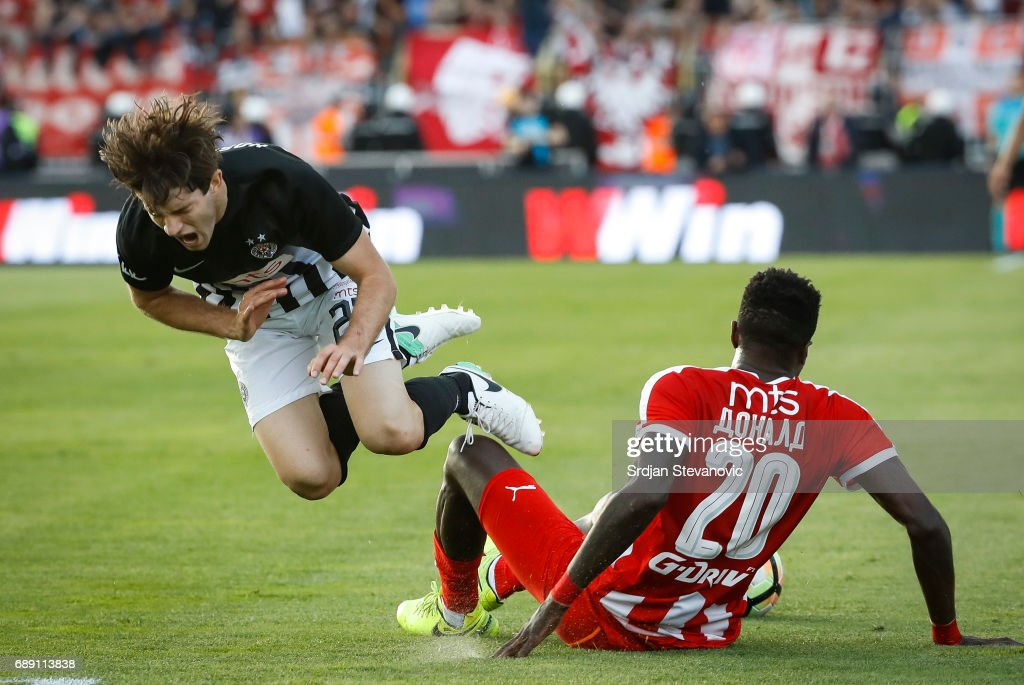 Nebojsa Kosovic (L) of Partizan is tackled by Mitchell Donald (R) during the final match of Serbian Cup between Fc Partizan and Fc Crvena Zvezda on May 27, 2017 in Belgrade, Serbia.
