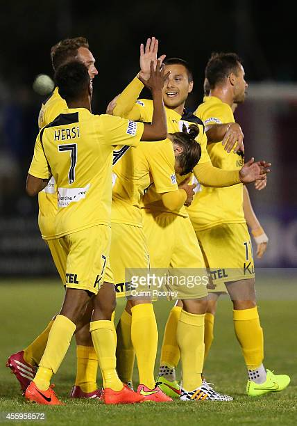 Nebojsa Marinkovic of Glory is congratulated by team mates after scoring a goal during the FFA Cup match between St Albans Saints and Perth Glory at...