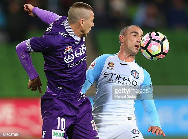 Nebojsa Marinkovic of the Glory heads the ball past Manny Muscat of the City during the round three ALeague match between Melbourne City FC and Perth...