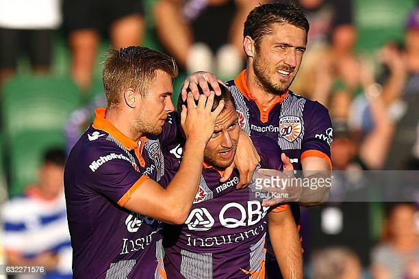 Nebojsa Marinkovic of the Glory is congratulated by Joseph Mills and Dino Djulbic after scoring a penalty during the round 16 ALeague match between...