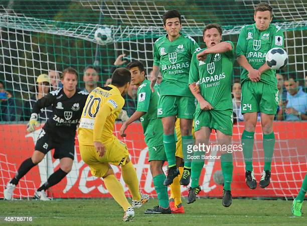 Nebosja Marinkovic of the Glory takes a free kick and scores the first goal past Bentleigh Greens defenders during the FFA Cup match between...