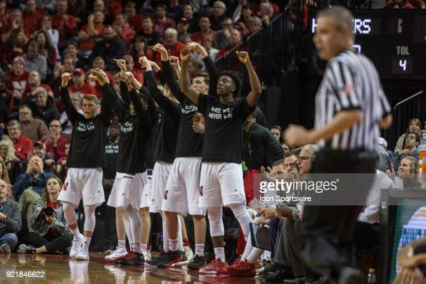 Nebraska bench acting like they are grabbing the rim celebrating a dunk against Indiana by Nebraska forward Isaiah Roby during the first half of a...