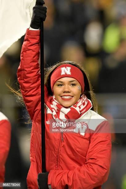 Nebraska cheerleader celebrates after a Cornhusker score during the Big Ten conference game between the Purdue Boilermakers and the Nebraska...