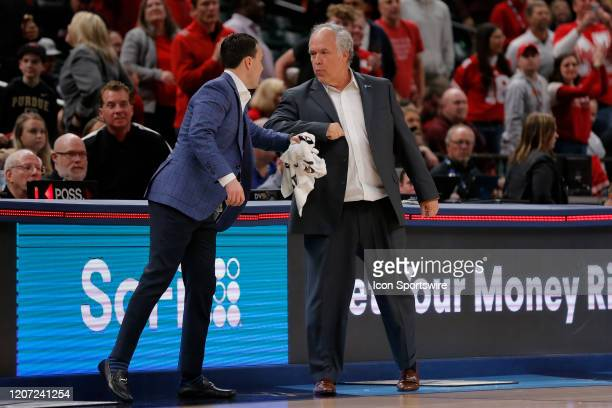 Nebraska Corn Huskers assistant coach Doc Sadler gives Indiana Hoosier Head Coach Archie Miller a elbow bump after the mens Big Ten Tournament game...