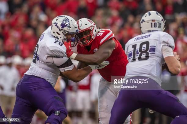 Nebraska Cornhusker defensive lineman Freedom Akinmoladun battles against Northwestern Wildcat offensive lineman Rashawn Slater putting pressure on...
