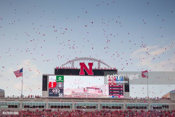 Nebraska Cornhusker fans release red balloons after the first score against the Arkansas State Red Wolves during the first half on September 02 2017...