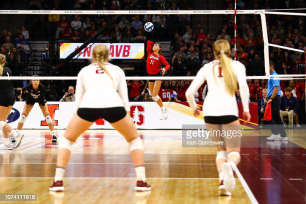Nebraska Cornhuskeres defensive specialist Kenzie Maloney serves the ball in the 3rd set during the match between the Stanford Cardinal and the...