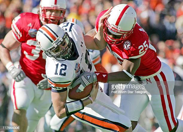 Nebraska Cornhuskers cornerback Andre Jones sacks Auburn Tigers quarterback Brandon Cox in the second quarter in the Cotton Bowl Classic in Dallas...
