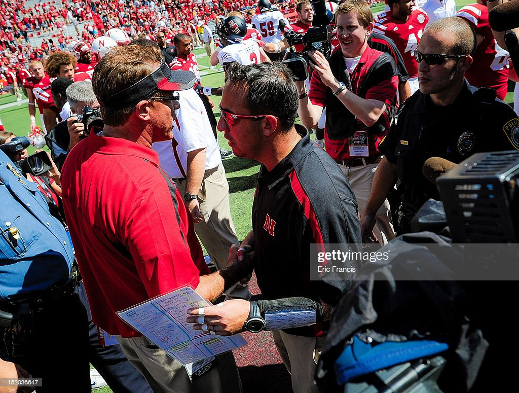 Nebraska Cornhuskers' defensive coordinator John Papuchis shakes hands with Arkansas State Red Wolves' head coach Gus Malzahn after their game at Memorial Stadium on September 15, 2012 in Lincoln, Nebraska. Nebraska won 42-13. Papuchis had to take the help of the Cornhuskers after Head Coach Bo Pelini was taken to the Hospital at halftime.