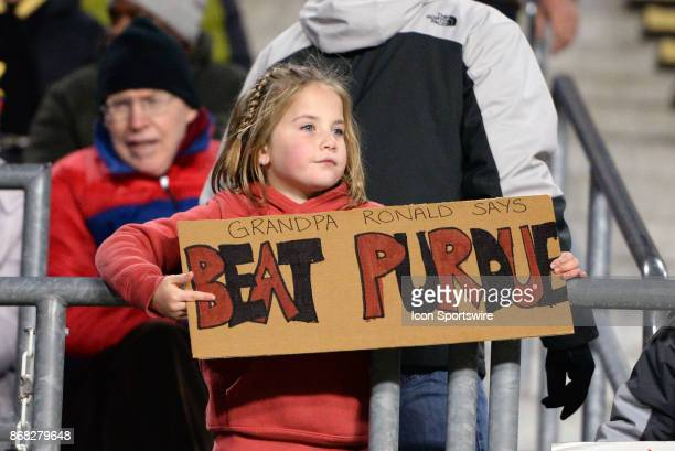 Nebraska Cornhuskers fan holds a sign saying 'Beat Purdue' during the Big Ten conference game between the Purdue Boilermakers and the Nebraska...
