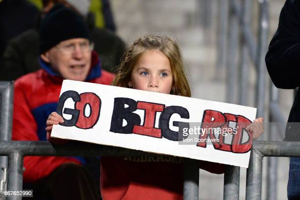 Nebraska Cornhuskers fan holds up a 'Go Big Red' sign during the Big Ten conference game between the Purdue Boilermakers and the Nebraska Cornhuskers...