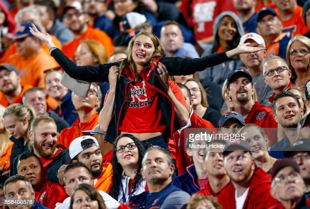 Nebraska Cornhuskers fan tries to get the attention of scoreboard cameras during the game against the Illinois Fighting Illini at Memorial Stadium on...