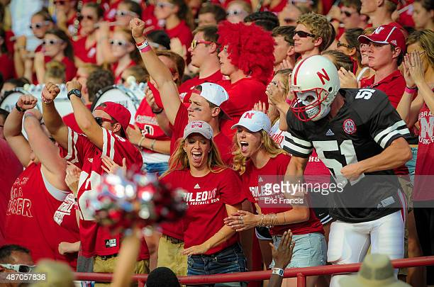 Nebraska Cornhuskers fans cheer during their game against the Brigham Young Cougars at Memorial Stadium on September 5 2015 in Lincoln Nebraska