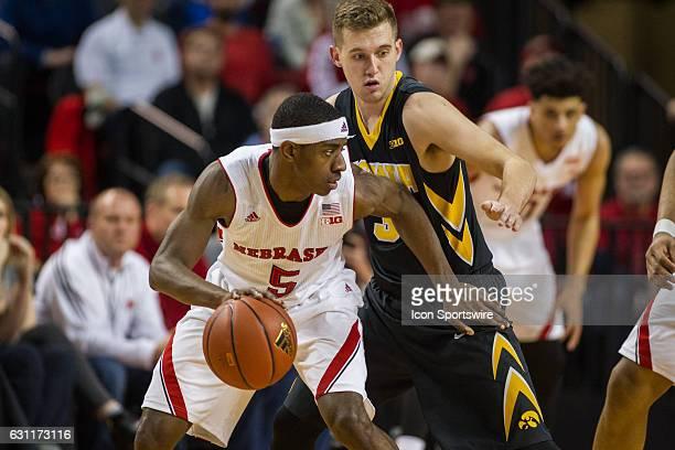 Nebraska Cornhuskers guard Glynn Watson Jr dribbles the ball with Iowa Hawkeyes guard Jordan Bohannon guarding him during the second half of an NCAA...