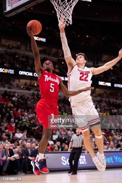 Nebraska Cornhuskers guard Glynn Watson Jr goes up for a shot against Wisconsin Badgers forward Ethan Happ during a Big Ten Tournament quarterfinal...