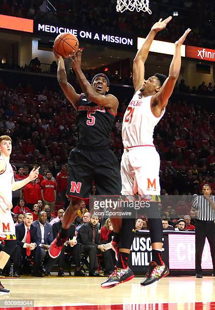 Nebraska Cornhuskers guard Glynn Watson Jr moves past Maryland Terrapins forward Justin Jackson for a shot during a Big 10 men's basketball game on...