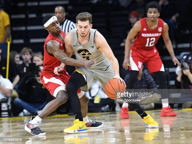 Nebraska Cornhuskers guard Glynn Watson tightly guard Iowa Hawkeyes guard Jordan Bohannon during a Big Ten Conference basketball game between the...