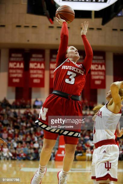 Nebraska Cornhuskers guard Hannah Whitish goes up and over Indiana Hoosier guard Tyra Buss for two during the game between the Nebraska Cornhuskers...