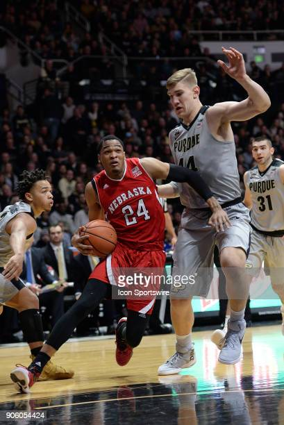 Nebraska Cornhuskers guard James Palmer Jr dribbles by Purdue Boilermakers center Isaac Haas during the Big Ten Conference college basketball game...