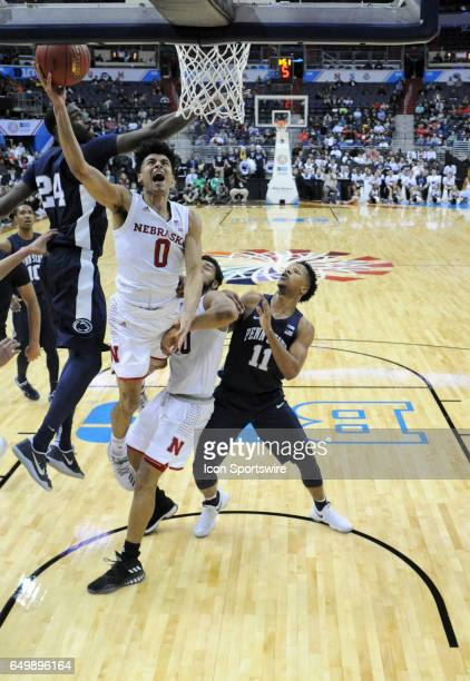 Nebraska Cornhuskers guard Tai Webster scores against Penn State Nittany Lions forward Lamar Stevens during the first round of the Big 10 Tournament...