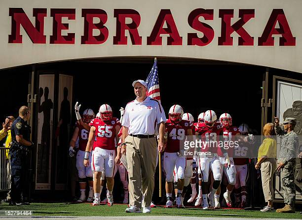 Nebraska Cornhuskers head coach Bo Pelini leads his team onto the field against the Idaho State Bengals at Memorial Stadium on September 22 2012 in...