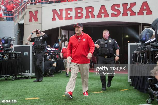 Nebraska Cornhuskers head coach Mike Riley walks of the tunnel walk after the team has taken the filed at Memorial Stadium in Lincoln Nebraska Red 55...