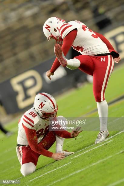 Nebraska Cornhuskers kicker Drew Brown warms up for the Big Ten conference game between the Purdue Boilermakers and the Nebraska Cornhuskers on...