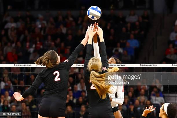 Nebraska Cornhuskers outside hitter Mikaela Foecke and Stanford Cardinal middle blocker Tami Alade go up for a ball in the 4th set during the match...