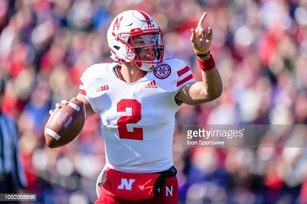 Nebraska Cornhuskers quarterback Adrian Martinez motions to a receiver while looking to pass in the 2nd quarter during a college football game...