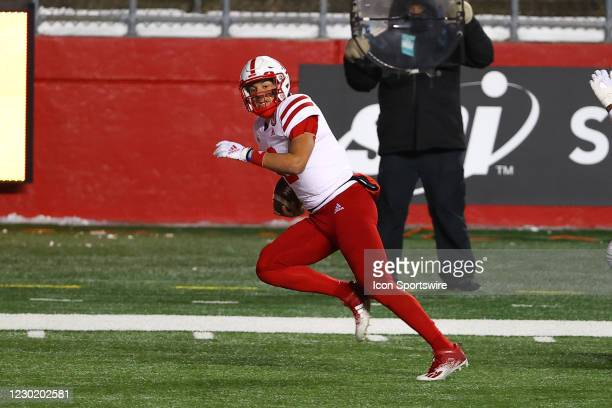 Nebraska Cornhuskers quarterback Adrian Martinez runs and scores a touchdown during the third quarter of the college football game between the...