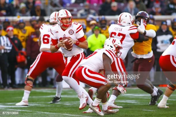 Nebraska Cornhuskers quarterback Tanner Lee drops back to pass during the Big Ten Conference game between the Nebraska Cornhuskers and the Minnesota...